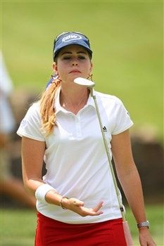 ROGERS, AR - JULY 4:  Paula Creamer tosses her putter after a putt during the first round of the P&G Beauty NW Arkansas Championship presented by John Q. Hammons on July 4, 2008 at Pinnacle Country Club in Rogers, Arkansas. (Photo by G. Newman Lowrance/Getty Images)