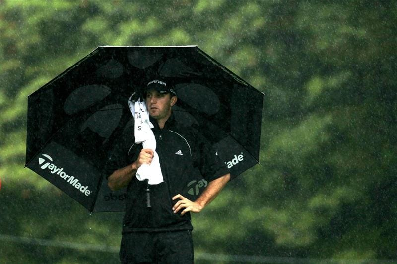 PACIFIC PALISADES, CA - FEBRUARY 05:  Dustin Johnson stands under his umbrella on the 12th hole during the second round of the Northern Trust Open at Riviera Country Club on February 5, 2010 in Pacific Palisades, California.  (Photo by Stephen Dunn/Getty Images)