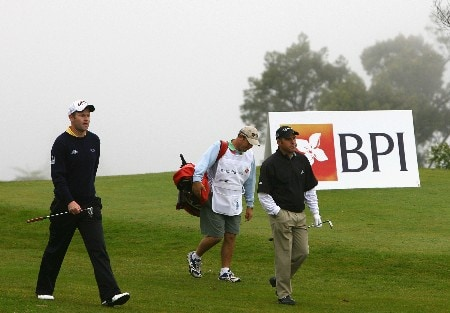 MADEIRA, PORTUGAL - MARCH 23:  Alastair Forsyth of Scotland and Hennie Otto of South Africa walk down the 18th fairway during the Madeira Islands Open BPI 2008 at Clube De Golf Santo Da Serra on March 23, 2008 in Madeira, Portugal.  (Photo by Ryan Pierse/Getty Images)