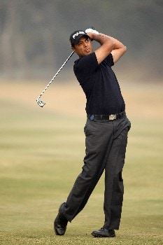 DELHI, INDIA - FEBRUARY 05:  Arjun Atwal of India hits his second shot to the 12th green during the Challenge Match, in the Emaar-MGF Indian Masters at the Delhi Golf Club on February 5, 2008 in Delhi, India.  (Photo by David Cannon/Getty Images)