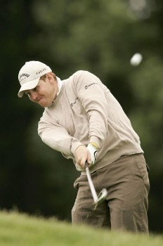 Stephen Gallacher hits his approach shot during the rain delayed second round of the 2005 Deutsche Bank Players Championship at Gut Kaden Golf Club in Hamburg, Germany on July 23, 2005.Photo by Pete Fontaine/WireImage.com