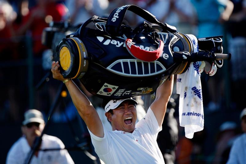 CHASKA, MN - AUGUST 16:  Y.E. Yang of South Korea celebrates his three-stroke victory on the 18th green during the final round of the 91st PGA Championship at Hazeltine National Golf Club on August 16, 2009 in Chaska, Minnesota.  (Photo by Streeter Lecka/Getty Images)