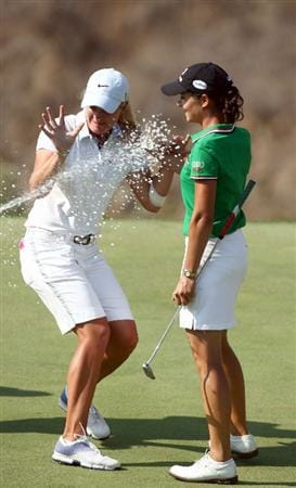 MORELIA, MEXICO- APRIL 26:  Lorena Ochoa of Mexico is sprayed by chapagne while Suzann Pettersen of Norway reacts after Ochoa's 25-under par victory during the final round of the Corona Championship at the Tres Marias Residential Golf Club on April 26, 2009 in Morelia, Michoacan, Mexico. (Photo by Donald Miralle/Getty Images)