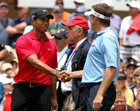 SAN DIEGO - JUNE 15:  Tiger Woods shakes hands with Lee Westwood of England on the first tee during the final round of the 108th U.S. Open at the Torrey Pines Golf Course (South Course) on June 15, 2008 in San Diego, California.  (Photo by Ross Kinnaird/Getty Images)