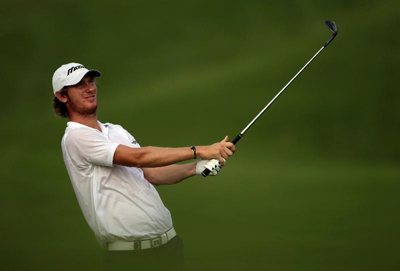 KUALA LUMPUR, MALAYSIA - MARCH 05:  Chris Wood of England plays his second shot on the 14th hole during the the second round of the Maybank Malaysian Open at the Kuala Lumpur Golf and Country Club on March 5, 2010 in Kuala Lumpur, Malaysia.  (Photo by Andrew Redington/Getty Images)