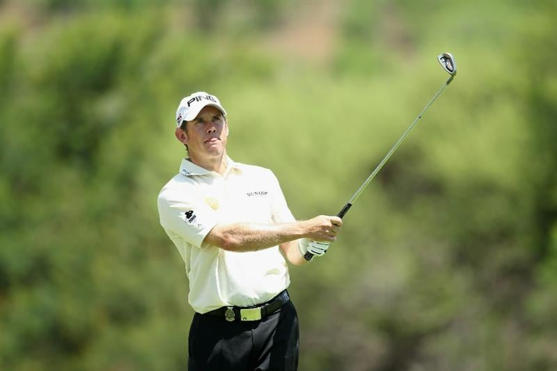 SUN CITY, SOUTH AFRICA - DECEMBER 05:  Lee Westwood of England plays his second shot into the third green during the final round of the 2010 Nedbank Golf Challenge at the Gary Player Country Club Course  on December 5, 2010 in Sun City, South Africa.  (Photo by Warren Little/Getty Images)
