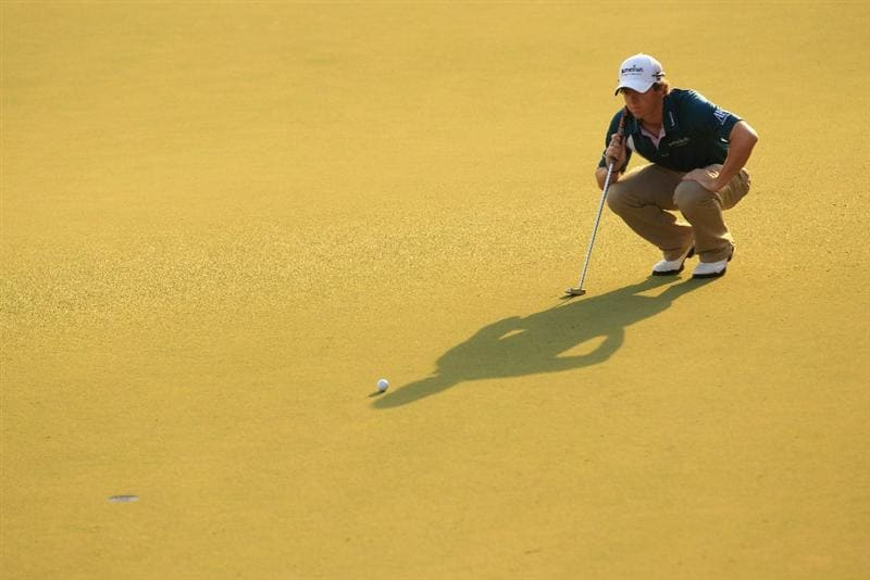 ABU DHABI, UNITED ARAB EMIRATES - JANUARY 23:  Rory McIlroy of Northern Ireland lines up a putt during the final round of The Abu Dhabi HSBC Golf Championship at Abu Dhabi Golf Club on January 23, 2011 in Abu Dhabi, United Arab Emirates.  (Photo by Andrew Redington/Getty Images)