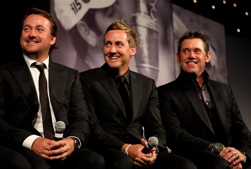 VIRGINIA WATER, ENGLAND - MAY 24:  (L-R)   Graeme McDowell, Ian Poulter and Lee Westwood of the 2010 European Ryder Cup team speak on stage during the European Tour Dinner at The Wentworth Club on May 24, 2011 in Virginia Water, England.  (Photo by Andrew Redington/Getty Images)