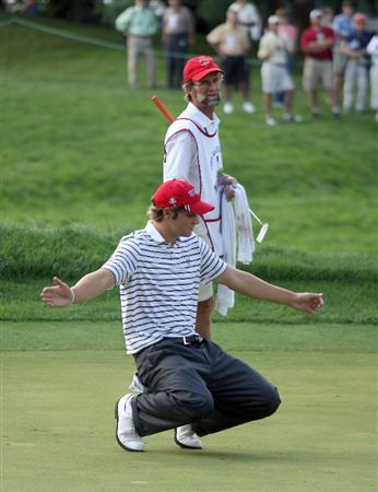 ARDMORE, PA - SEPTEMBER 13:  Peter Uihlein of the USA reacts to the putt of his partner Nathan Smith who just missed a putt to win their match on the 13th green agaiinst Chris Paisley and Dale Whitnell of England and the Great Britain and Irelnad Team during the morning foursome matches on the East Course at Merion Golf Club on September 13, 2009 in Ardmore, Pennsylvania.  (Photo by David Cannon/Getty Images)