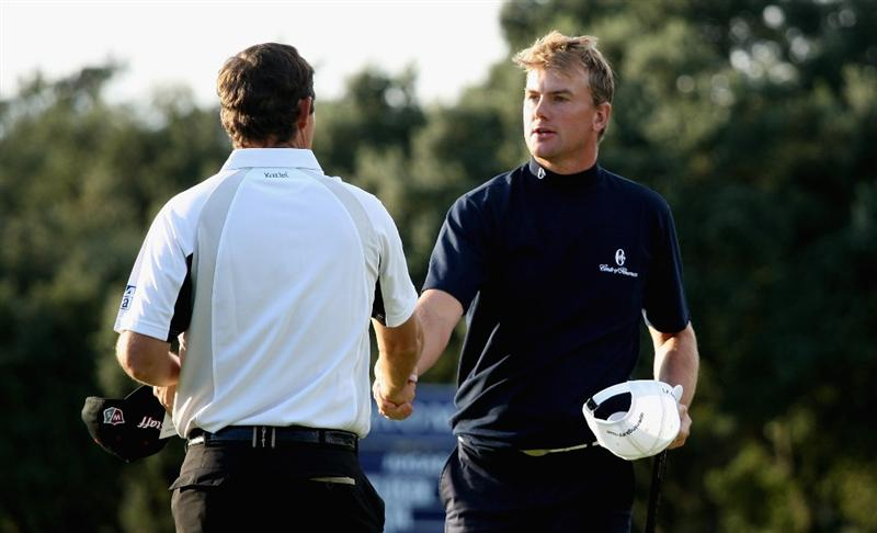 SOTOGRANDE, SPAIN - OCTOBER 30:  Robert Karlsson of Sweden and Padraig Harrington of Ireland on the 18th hole during the first round of the Volvo Masters at the Valderrama Golf Club on October 30, 2008 in Sotogrande, Spain.  (Photo by Ross Kinnaird/Getty Images)