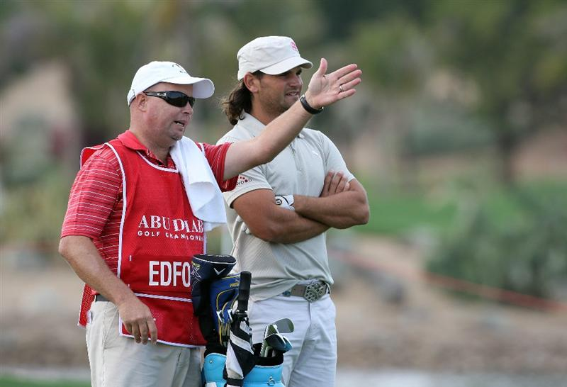 ABU DHABI, UNITED ARAB EMIRATES - JANUARY 15:  Johan Edfors of Sweden prepares to play his second shot at the 9th hole during the first round of the Abu Dhabi Golf Championship held at the Abu Dhabi Golf Club on January 15, 2009 in Abu Dhabi, United Arab Emirates  (Photo by David Cannon/Getty Images)