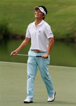 MEMPHIS, TN - JUNE 10: Ryuji Imada of Japan reacts after making his putt on the first hole during the first round of the St. Jude Classic at TPC Southwind held on June 10, 2010 in Memphis, Tennessee. (Photo by John Sommers II/Getty Images)