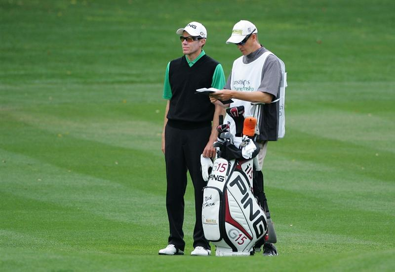PALM HARBOR, FL - MARCH 21:  Nick O'Hern (L) of Australia stands by his bag on the first fairway during the final round of the Transitions Championship at the Innisbrook Resort and Golf Club on March 21, 2010 in Palm Harbor, Florida.  (Photo by Michael Cohen/Getty Images)