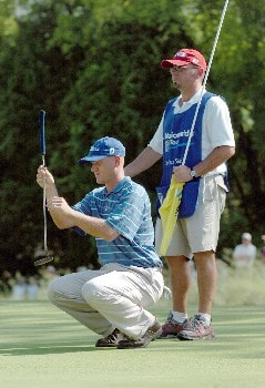 Jason Schultz and his caddie line up his putt during the Final Round of the Chattanooga Classic  at Black Creek Club in Chattanooga, Tennessee on June 5, 2005.Photo by Joe Murphy/WireImage.com