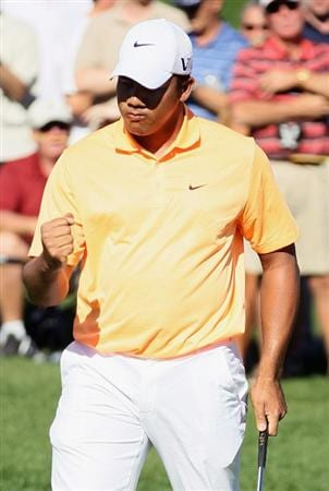 LA QUINTA, CA - JANUARY 23:  Jhonattan Vegas of Venezuela pumps his fist after making an eagle putt on the sixth hole during the final round of the Bob Hope Classic at the Palmer Private course at PGA West on January 23, 2011 in La Quinta, California.  (Photo by Jeff Gross/Getty Images)
