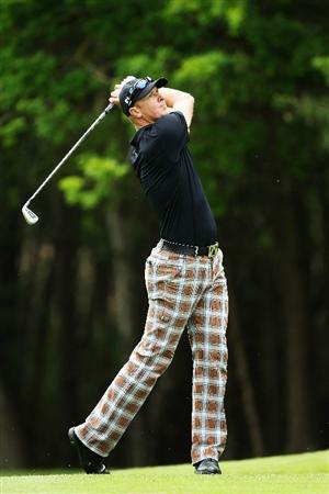 VIRGINIA WATER, ENGLAND - MAY 20:  Fredrik Andersson Hed of Sweden plays his second shot at the 13th hole during the first round of the BMW PGA Championship on the West Course at Wentworth on May 20, 2010 in Virginia Water, England.  (Photo by David Cannon/Getty Images)