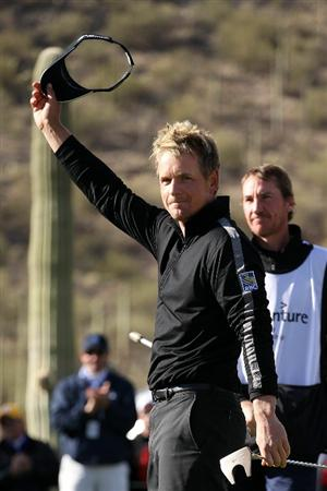 MARANA, AZ - FEBRUARY 27:  Luke Donald of England waves to fans after winning his match 3-up over Martin Kaymer of Germany (not pictured) as his caddie John McLaren (R) looks on during the final round of the Accenture Match Play Championship at the Ritz-Carlton Golf Club on February 27, 2011 in Marana, Arizona.  (Photo by Andy Lyons/Getty Images)