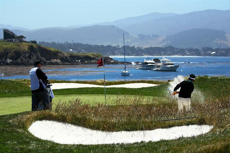 PEBBLE BEACH, CA - JUNE 17:  K.J. Choi of South Korea plays a bunker shot on the 17th hole during the first round of the 110th U.S. Open at Pebble Beach Golf Links on June 17, 2010 in Pebble Beach, California.  (Photo by Andrew Redington/Getty Images)