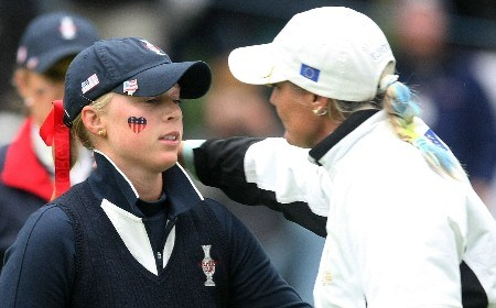 HALMSTAD, SWEDEN - SEPTEMBER 14:  Maria Hjorth of Europe, (R) hugs Morgan Pressel after her 3&2 victory with Gwladys Nocera over the USA team of Gulbis/Pressel during the morning foursome matches of the Solheim Cup at on September 14, 2007 in Halmstad, Sweden.  (Photo by Scott Halleran/Getty Images)