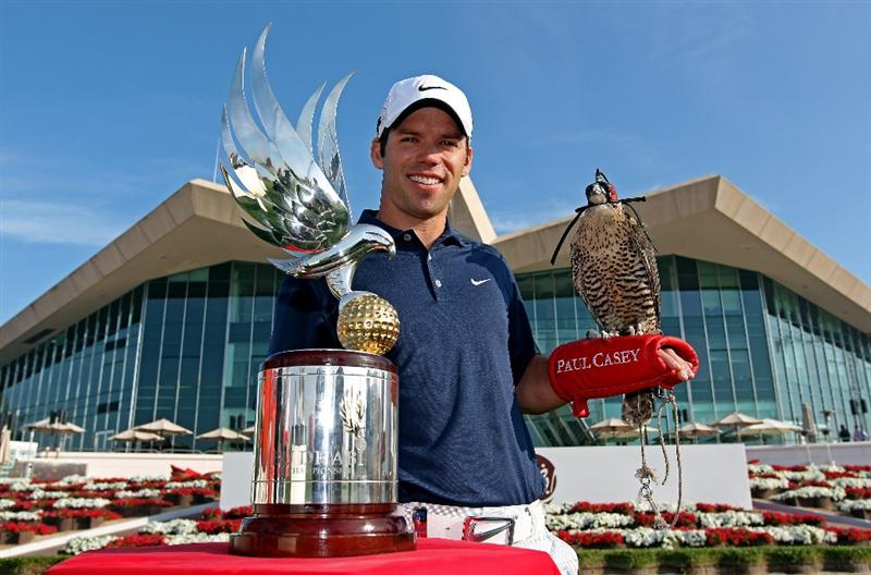ABU DHABI, UNITED ARAB EMIRATES - JANUARY 19:  Paul Casey of England, the defending champion, poses for a photograph alongside the trophy with a falcon on his arm in front of the clubhouse during a photocall at The Abu Dhabi Golf Championship at Abu Dhabi Golf Club on January 19, 2010 in Abu Dhabi, United Arab Emirates.  (Photo by Andrew Redington/Getty Images)