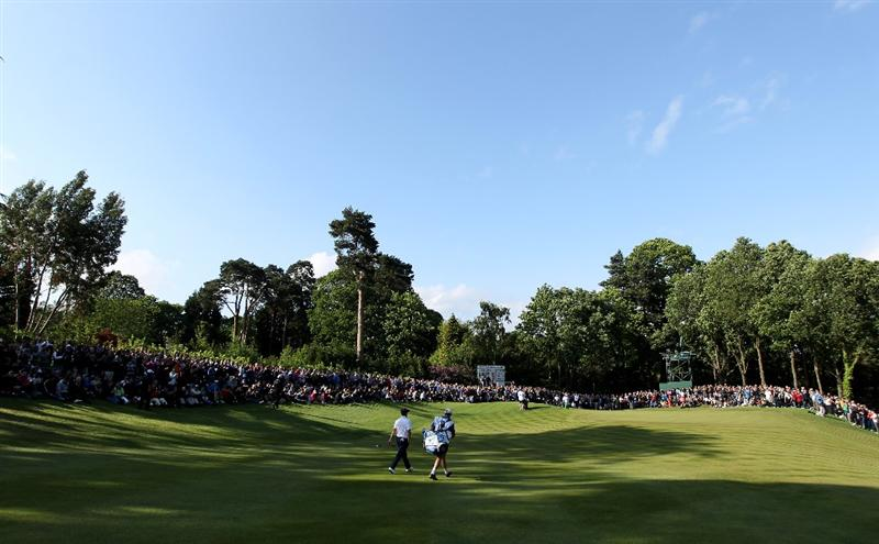 VIRGINIA WATER, ENGLAND - MAY 29:  Luke Donald of England walks down the 17th hole during the final round of the BMW PGA Championship  at the Wentworth Club on May 29, 2011 in Virginia Water, England.  (Photo by Warren Little/Getty Images)