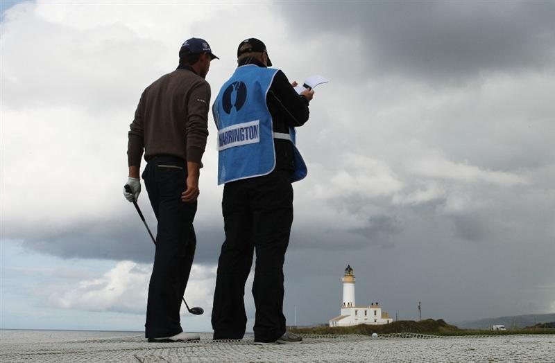 TURNBERRY, SCOTLAND - JULY 14:  Padraig Harrington of Ireland chats with his caddie Ronan Flood during a practice round prior to the 138th Open Championship on the Ailsa Course, Turnberry Golf Club on July 14, 2009 in Turnberry, Scotland.  (Photo by Warren Little/Getty Images)