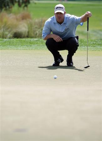 PALM BEACH GARDENS, FL - MARCH 08:  John Rollins lines up a birdie putt on the third hole during the final round of The Honda Classic at PGA National Resort and Spa on March 8, 2009 in Palm Beach Gardens, Florida.  (Photo by Doug Benc/Getty Images)