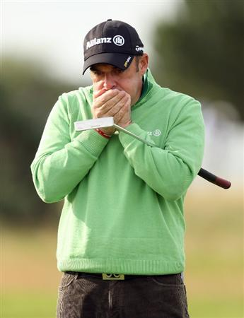CARNOUSTIE, SCOTLAND - OCTOBER 01:  Paul McGinley of Ireland feels the cold during the first round of The Alfred Dunhill Links Championship at Carnoustie Golf Club on October 1, 2009 in Carnoustie, Scotland.(Photo by Ross Kinnaird/Getty Images)