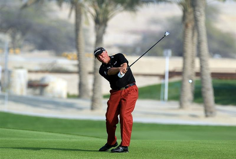 BAHRAIN, BAHRAIN - JANUARY 30:  Darren Clarke of Nortehrn Ireland plays his second shot at the 9th hole during the final round of the 2011 Volvo Champions held at the Royal Golf Club on January 30, 2011 in Bahrain, Bahrain.  (Photo by David Cannon/Getty Images)