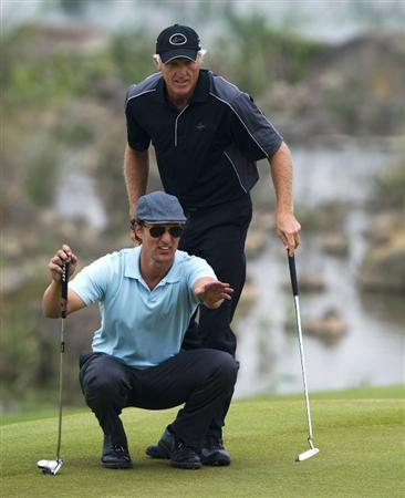 HAIKOU, CHINA - OCTOBER 31:  Hollywood actor Matthew McConaughey lines up a putt on the 16th green near Greg Norman of Australia during day five of the Mission Hills Start Trophy at Mission Hills Resort on October 31, 2010 in Haikou, China.  The Mission Hills Star Trophy is Asia's leading leisure liflestyle event and features Hollywood celebrities and international golf stars.  (Photo by Victor Fraile/Getty Images for Mission Hills)
