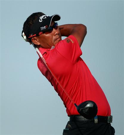 BAHRAIN, BAHRAIN - JANUARY 29:  Thongchai Jaidee of Thailand hits his tee-shot on the first hole during the third round of the Volvo Golf Champions at The Royal Golf Club on January 29, 2011 in Bahrain, Bahrain.  (Photo by Andrew Redington/Getty Images)