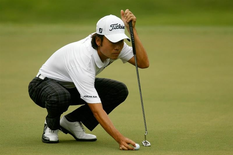 ATLANTA - SEPTEMBER 26:  Kevin Na places his ball on the second green during the final round of THE TOUR Championship presented by Coca-Cola at East Lake Golf Club on September 26, 2010 in Atlanta, Georgia.  (Photo by Scott Halleran/Getty Images)