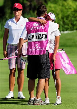 EVIAN-LES-BAINS, FRANCE - JULY 26:  JULY 26:  JULY 26:  JULY 26:  Ai Miyazato of Japan celebrates winning with her caddie on the first playoff hole, the 18th,  after beating Sofie Gustafson of Sweden after the final round of the Evian Masters at the Evian Masters Golf Club on July 26, 2009 in Evian-les-Bains, France.  (Photo by Stuart Franklin/Getty Images)
