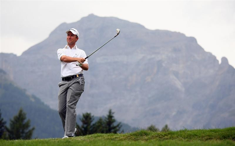 CRANS, SWITZERLAND - SEPTEMBER 06:  Mark Foster of England hits his second shot on the 12th hole during the third round of the Omega European Masters at Crans-Sur-Sierre Golf Club on September 6, 2008 in Crans Montana, Switzerland.  (Photo by Andrew Redington/Getty Images)