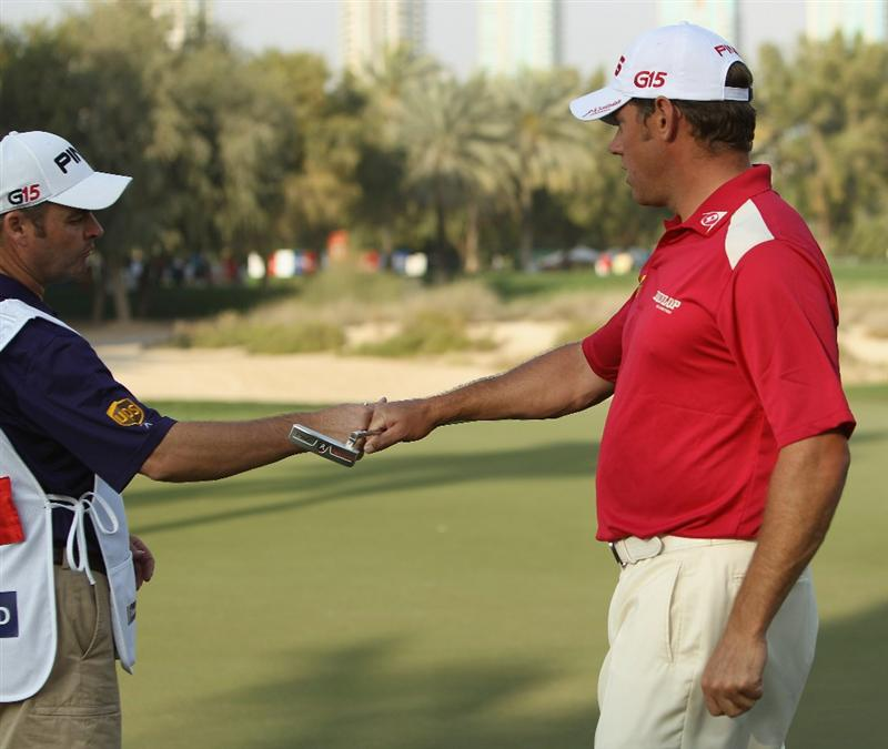 DUBAI, UNITED ARAB EMIRATES - FEBRUARY 10:  Lee Westwood of England celebrates a put with his caddie during the first round for the 2011 Omega Dubai desert Classic held on the Majilis Course at the Emirates Golf Club on February 10, 2011 in Dubai, United Arab Emirates.  (Photo by Ian Walton/Getty Images)