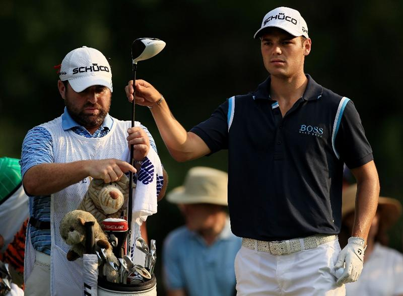 PONTE VEDRA BEACH, FL - MAY 12:  Martin Kaymer of Germany (R) pulls a club from his bag alongside his caddie Craig Connelly on the second hole tee during the first round of THE PLAYERS Championship held at THE PLAYERS Stadium course at TPC Sawgrass on May 12, 2011 in Ponte Vedra Beach, Florida.  (Photo by Streeter Lecka/Getty Images)