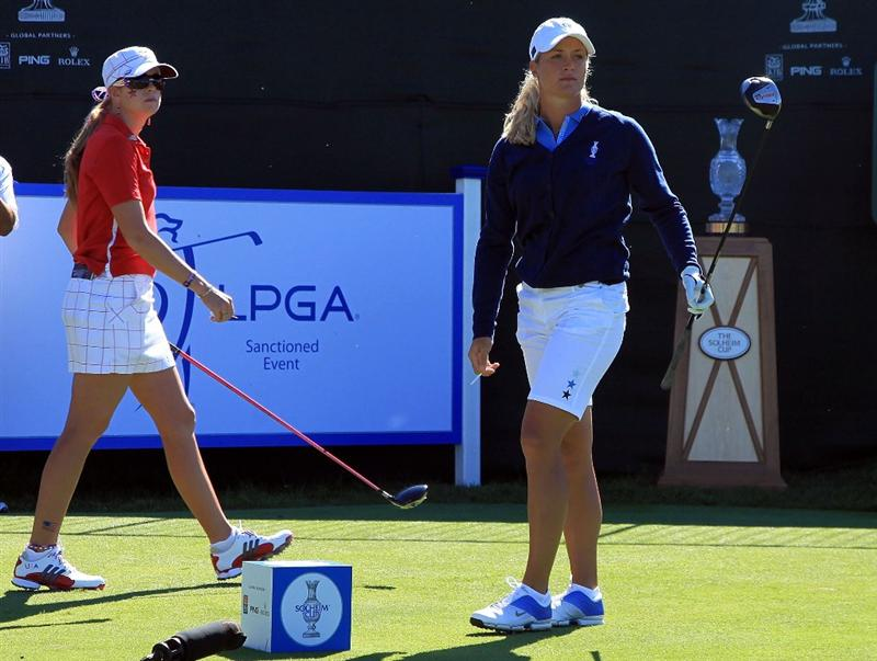 SUGAR GROVE, IL - AUGUST 23:  Suzann Pettersen of the European Team watches her tee shot on the first hole as Paula Creamer of the U.S. Team looks on during the Sunday singles matches at the 2009 Solheim Cup at Rich Harvest Farms on August 23, 2009 in Sugar Grove, Illinois.  (Photo by David Cannon/Getty Images)