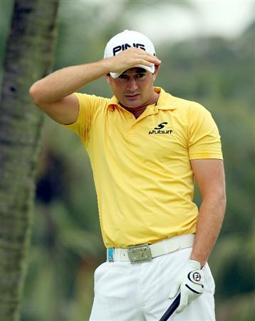 SINGAPORE - NOVEMBER 11: Gareth Maybin of Northern Ireland reacts on a putt on the 3rd hole during the First Round of the Barclays Singapore Open at Sentosa Golf Club on November 11, 2010 in Singapore, Singapore.  (Photo by Stanley Chou/Getty Images)