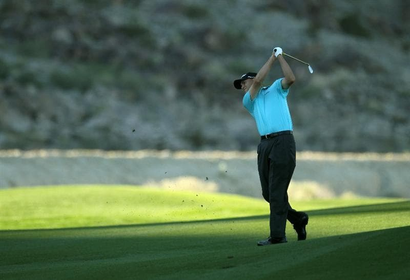 LA QUINTA, CA - JANUARY 23:  Bill Haas hits his second shot on the 14th hole during the final round of the Bob Hope Classic on the Palmer Private Course at PGA West on January 23, 2011 in La Quinta, California.  (Photo by Stephen Dunn/Getty Images)