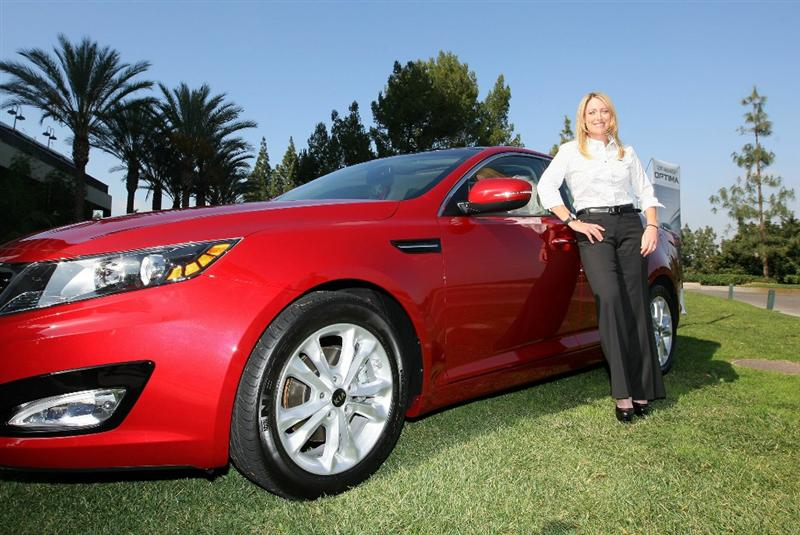 CITY OF INDUSTRY, CA - FEBRUARY 01:  LPGA Player Cristie Kerr stands in front of the Kia Optima automobile during Kia Classic Media Day at Pacific Palms Resort on February 1, 2011 in City of Industry, California.  (Photo by Victor Decolongon/Getty Images)
