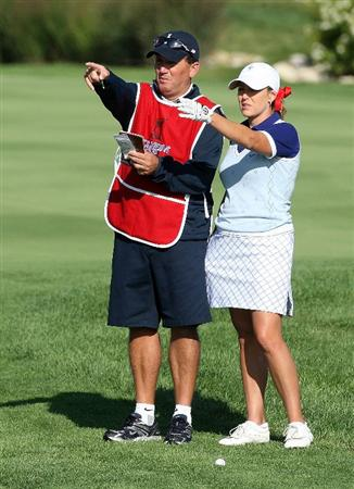 SUGAR GROVE, IL - AUGUST 22:  Cristie Kerr of the U.S. Team chats with her caddie John Killeen on the second hole during the saturday morning fourball matches at the 2009 Solheim Cup at Rich Harvest Farms on August 22, 2009 in Sugar Grove, Illinois.  (Photo by David Cannon/Getty Images)