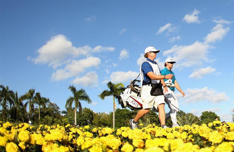 DORAL, FL - MARCH 12:  Hunter Mahan walks with his caddie John Wood walks off the 15th tee during the third round of the 2011 WGC- Cadillac Championship at the TPC Blue Monster at the Doral Golf Resort and Spa on March 12, 2011 in Doral, Florida.  (Photo by Mike Ehrmann/Getty Images)