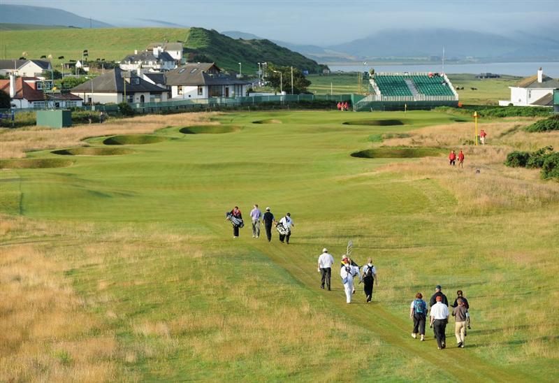 TURNBERRY, SCOTLAND - JULY 16:  The first group heads down the first fairway during round one of the 138th Open Championship on the Ailsa Course, Turnberry Golf Club on July 16, 2009 in Turnberry, Scotland.  (Photo by Harry How/Getty Images)