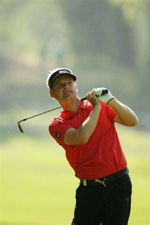 VIRGINIA WATER, ENGLAND - MAY 21:  Soren Kjeldsen of Denmark plays an iron shot during the second round of the BMW PGA Championship on the West Course at Wentworth on May 21, 2010 in Virginia Water, England.  (Photo by Ian Walton/Getty Images)