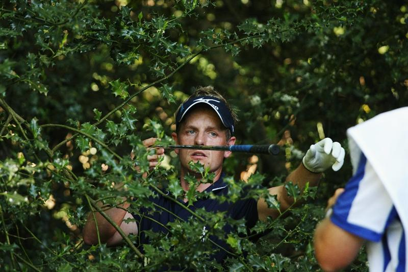 VIRGINIA WATER, ENGLAND - MAY 23:  Luke Donald of England finds himself in the trees at the 17th hole during the final round of the BMW PGA Championship on the West Course at Wentworth on May 23, 2010 in Virginia Water, England.  (Photo by Ross Kinnaird/Getty Images)