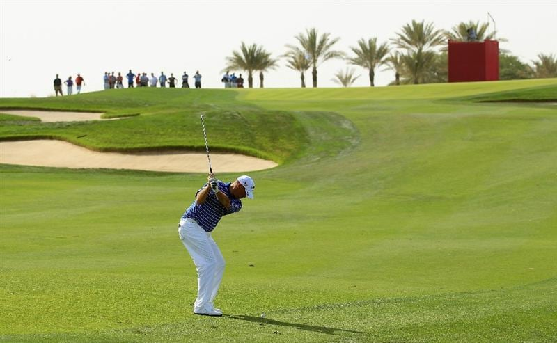 DOHA, QATAR - FEBRUARY 05:  Thomas Bjorn of Denmark plays his second shot on the seventh hole during the third round of the Commercialbank Qatar Masters held at Doha Golf Club on February 5, 2011 in Doha, Qatar.  (Photo by Andrew Redington/Getty Images)