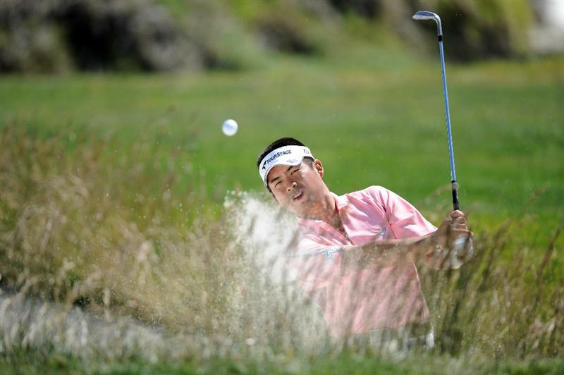 PEBBLE BEACH, CA - JUNE 16:  Yuta Ikeda of Japan hits a bunker shot during a practice round prior to the start of the 110th U.S. Open at Pebble Beach Golf Links on June 16, 2010 in Pebble Beach, California.  (Photo by Harry How/Getty Images)