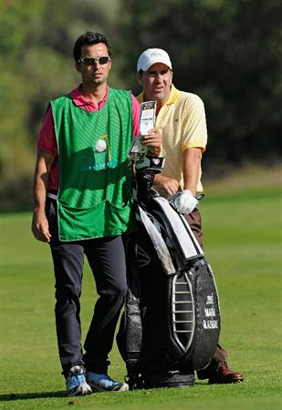 CASTELLON DE LA PLANA, SPAIN - OCTOBER 22:  Jose Maria Olazabal of Spain and caddie Alex Larrazabal discuss his approach shot on the 10th hole during the second round of the Castello Masters Costa Azahar at the Club de Campo del Mediterraneo on October 22, 2010 in Castellon de la Plana, Spain.  (Photo by Stuart Franklin/Getty Images)