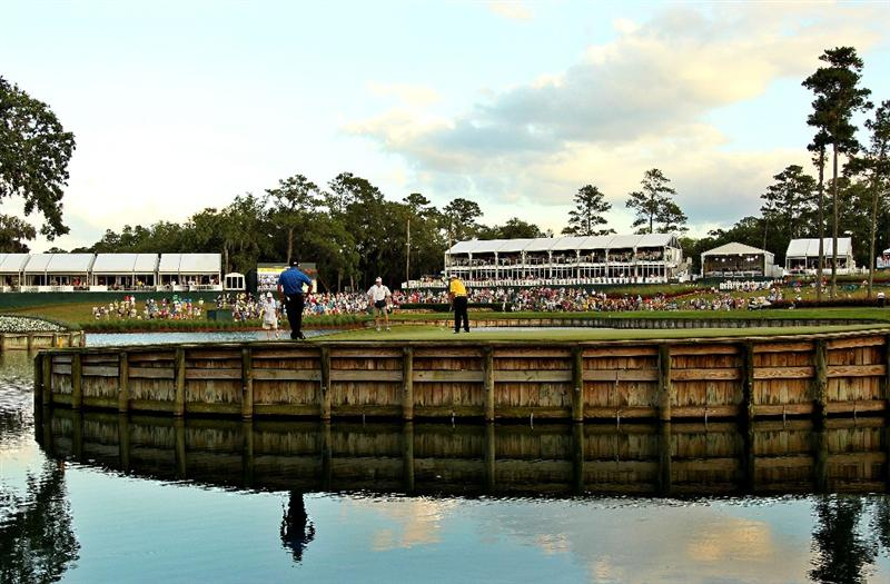 PONTE VEDRA BEACH, FL - MAY 15:  David Toms putts on the 17th hole as K.J. Choi of South Korea looks on during the final round of THE PLAYERS Championship held at THE PLAYERS Stadium course at TPC Sawgrass on May 15, 2011 in Ponte Vedra Beach, Florida.  (Photo by Mike Ehrmann/Getty Images)