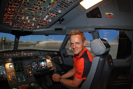 ABU DHABI, UNITED ARAB EMIRATES - JANUARY 16:  Luke Donald of England in the cockpit of an Airbus 330 in the Etihad Airways Flight Simulator centre at Abu Dhabi Airport on January 16, 2007 in Abu Dhabi United Arab Emirates.  (Photo by David Cannon/Getty Images for Etihad Airways)